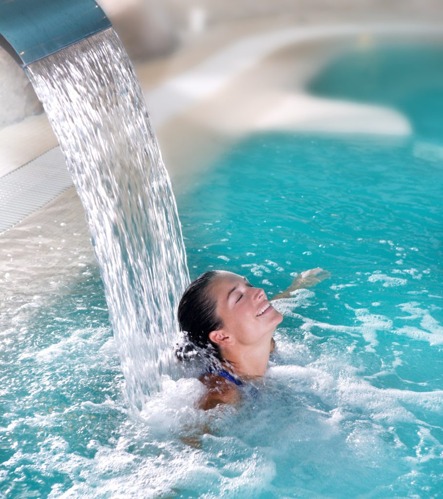 spa hydrotherapy woman waterfall jet turquoise swimming pool water